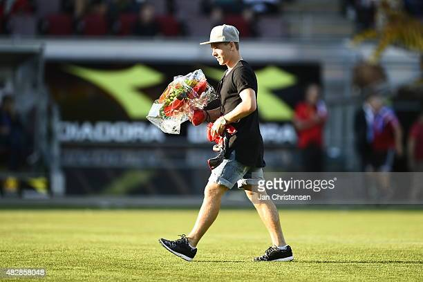 Former player of FC Nordsjalland Uffe Bech receiving flowers prior to the Danish Alka Superliga match between FC Nordsjalland and AaB Aalborg at...