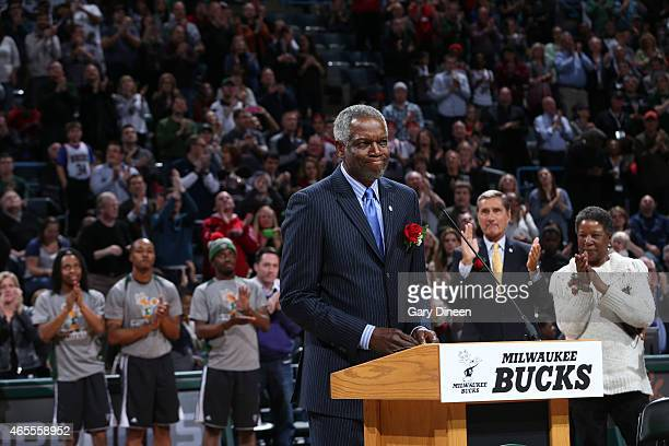 Former player of the Milwaukee Bucks Bob Dandridge is honored by having his jersey retired during the game against the Washington Wizards on March 7,...