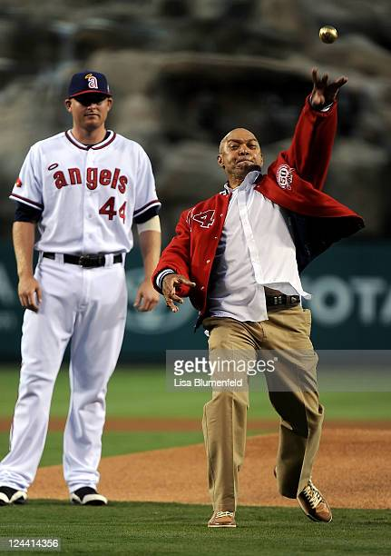 Former Player Reggie Jackson throws out the first pitch before the game between the New York Yankees and the Los Angeles Angels of Anaheim at Angel...