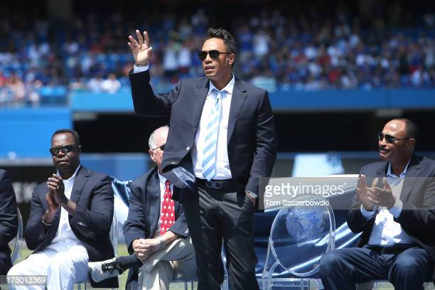 Former player Roberto Alomar attends a pregame ceremony for Carlos Delgado of the Toronto Blue Jays who is honored by having his name placed on The...
