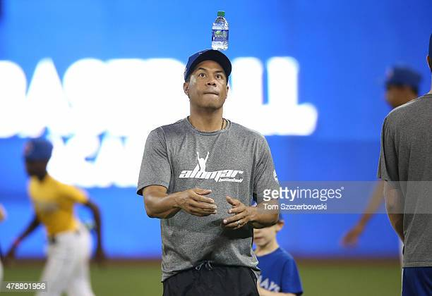 Former player Roberto Alomar of the Toronto Blue Jays conducts a clinic for kids after the end of the Blue Jaysâ MLB game against the Baltimore...