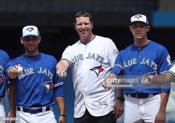 Former player Roy Halladay of the Toronto Blue Jays posed with Marco Estrada and Aaron Sanchez during 40th anniversary celebrations before the start...