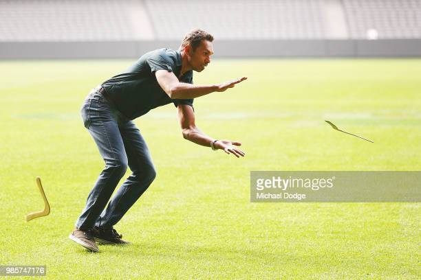 Former player Scott Chisolm catches a Boomerang during an Indigenous Past Player Group announcement at Etihad Stadium on June 28 2018 in Melbourne...