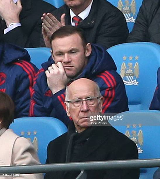 Former player Sir Bobby Charlton and Wayne Rooney of Manchester United watch from the directors box during the Barclays Premier League match between...