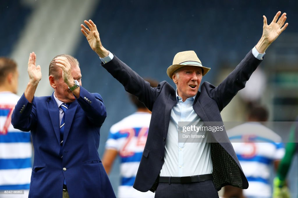 Former player Stan Bowles receives the applause of the fans next to Don Shanks before his benefit match and pre-season friendly match between Queens Park Rangers and AFC Bournemouth at Loftus Road on July 29, 2017 in London, England.