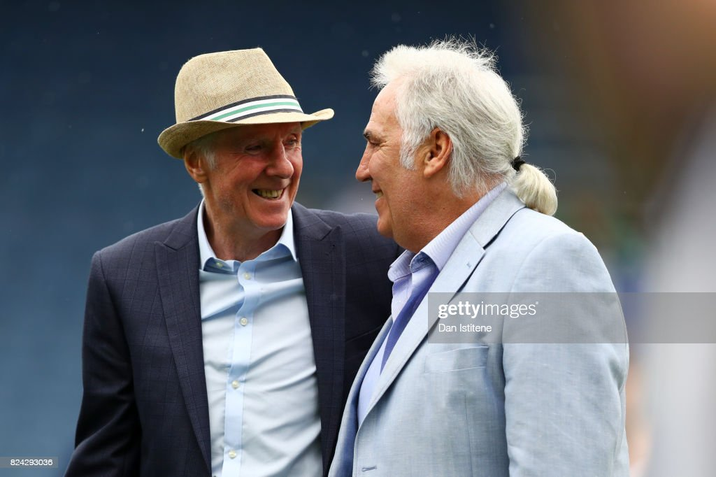 Former player Stan Bowles receives the applause of the fans next to Gerry Francis before his benefit match and pre-season friendly match between Queens Park Rangers and AFC Bournemouth at Loftus Road on July 29, 2017 in London, England.