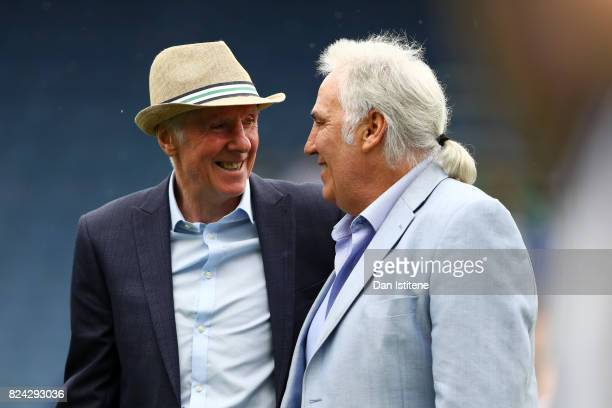 Former player Stan Bowles receives the applause of the fans next to Gerry Francis before his benefit match and preseason friendly match between...