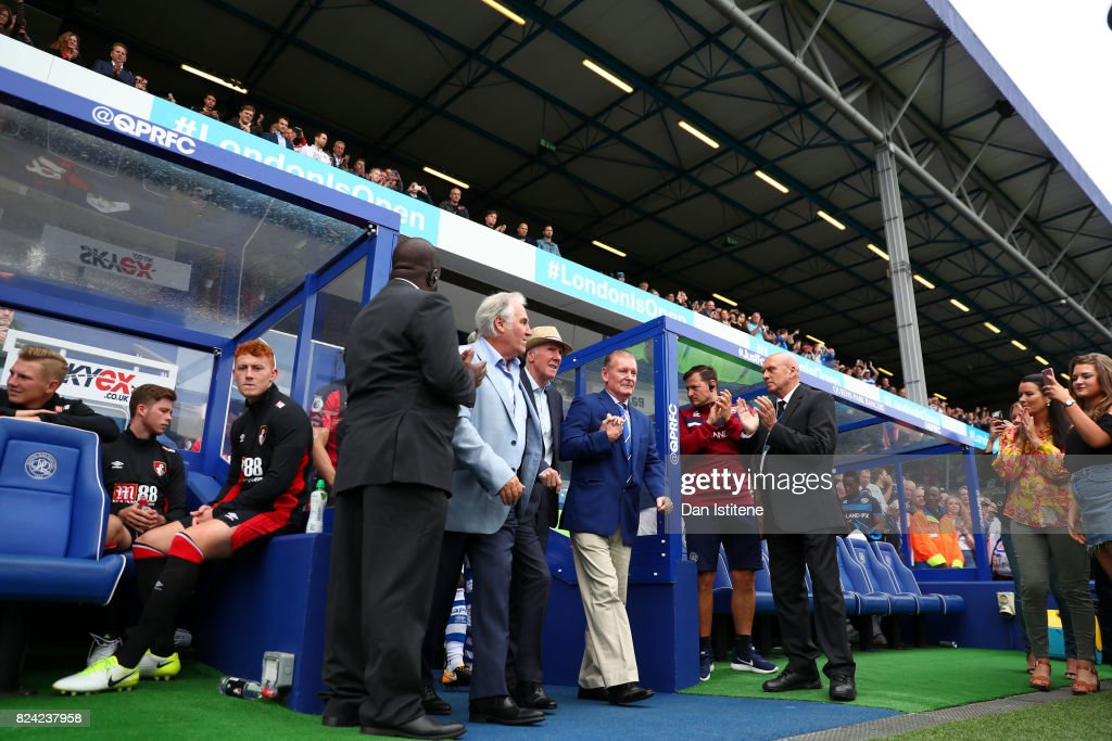 Former player Stan Bowles walks out on to the pitch to receive the applause of the fans next to Don Shanks and Gerry Francis before his benefit match and pre-season friendly match between Queens Park Rangers and AFC Bournemouth at Loftus Road on July 29, 2017 in London, England.