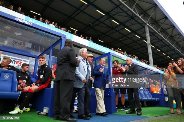 Former player Stan Bowles walks out on to the pitch to receive the applause of the fans next to Don Shanks and Gerry Francis before his benefit match...