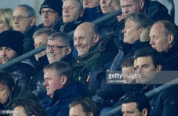 Former player Thomas Gravesen and Age Hareide, national team coach of Denmark looks on from the main stand during the Danish Alka Superliga match...