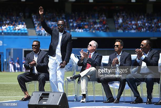 Former player Tony Fernandez acknowledges the crowd as he is introduced during a pregame ceremony for former player Carlos Delgado of the Toronto...