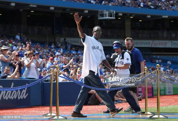 Former player Tony Fernandez of the Toronto Blue Jays acknowledges the fans during pregame ceremonies honoring the club's backtoback World Series...