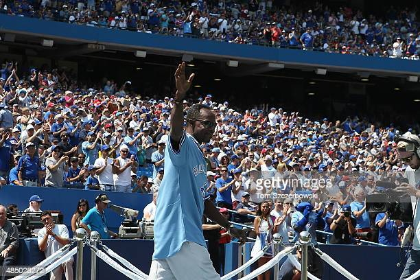 Former player Tony Fernandez of the Toronto Blue Jays acknowledges the fansâ ovation during a ceremony commemorating the 30th anniversary of the Blue...
