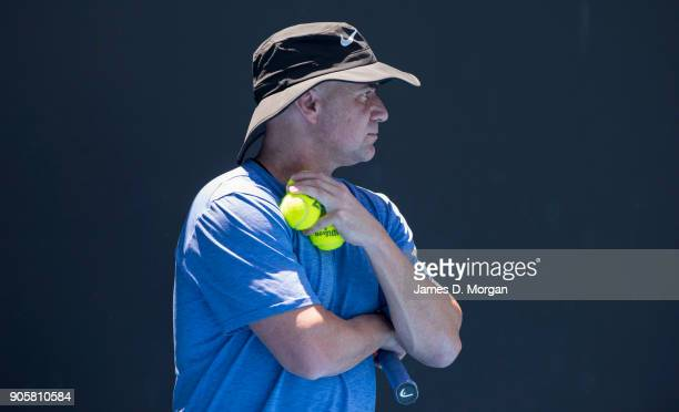 Former player turned coach Andre Agassi watches Novak Djokovic practice in the heat on day three of the 2018 Australian Open at Melbourne Park on...