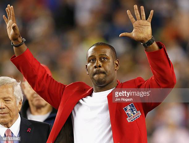 Former player Ty Law off the New England Patriots is recognized in a halftime ceremony during a game against the New York Jets at Gillette Stadium on...