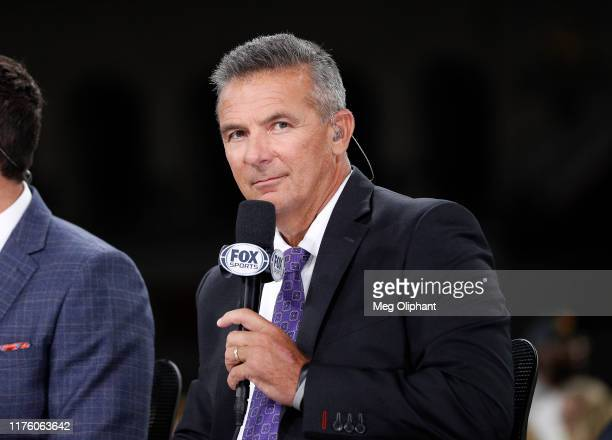 Former player Urban Meyer rumored to be the next USC head coach appears at the USC game against the Utah Utes at Los Angeles Memorial Coliseum on...