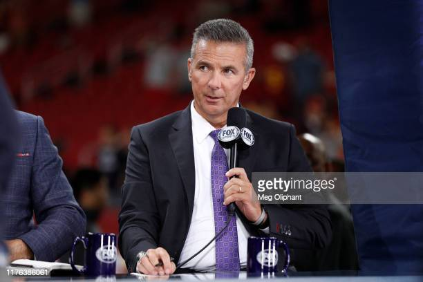 Former player Urban Meyer, rumored to be the next USC head coach, appears at the USC game against the Utah Utes at Los Angeles Memorial Coliseum on...
