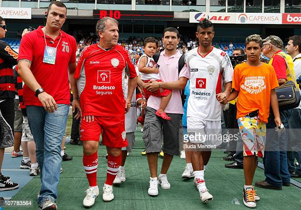 Former player Zico and player Leo Moura enter the field during the Jogo das Estrelas Charity Soccer Match between CR Flamengo Stars and Friends of...