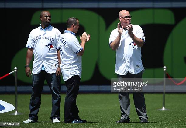 Former players Devon White and John McDonald and Ed Sprague during the franchiseu2019s fortieth anniversary celebrations before the start of MLB game...