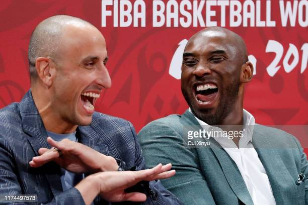 Former players Emanuel Ginobili Kobe Bryant react during the semifinals march between Spain and Australia of 2019 FIBA World Cup at the Cadillac...