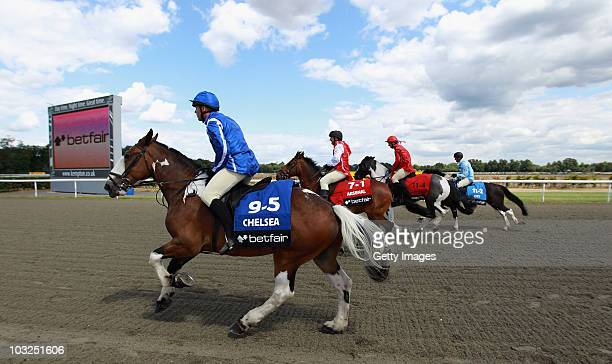 Former players Kerry Dixon Ray Parlour David May and Steve Lomas compete during the Betfair Five Horse Race at Kempton Park racecourse on August 5...