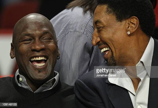 Former players Michael Jordan and Scottie Pippen of the Chicago Bulls share a laugh before a game between the Bulls and the Charlotte Bobcats at the...