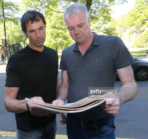 Former players Raimond van der Gouw and Gary Pallister read the local newspaper ahead of the UEFA Europa League Final match between Manchester United...