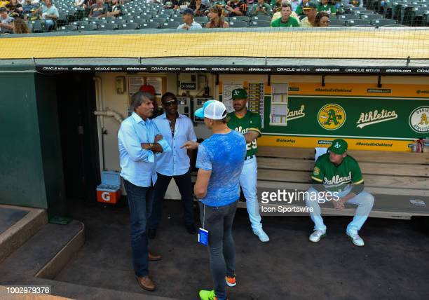 Former players Ricky Henderson and Dennis Eckersley hanging out in the dugout before the MLB game between the Oakland Athletics and the San Francisco...