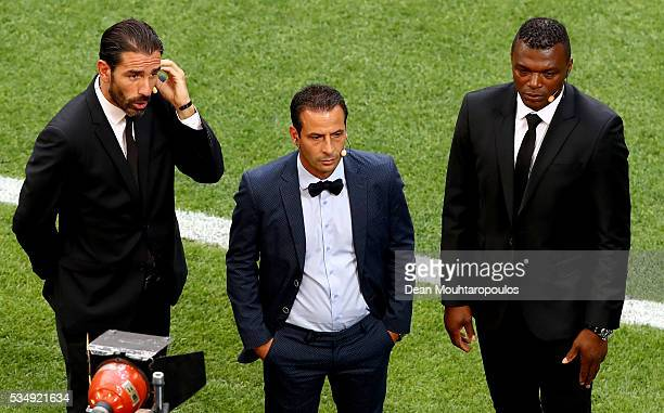 Former players Robert Pires Ludovic Giuly and Marcel Desailly take up their media positions pitchside prior to the UEFA Champions League Final match...
