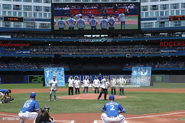 Former players Roberto Alomar of the Toronto Blue Jays and Joe Carter throw out the first pitches to Russell Martin and Troy Tulowitzki respectively...