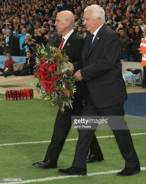 Former plkayers Sir Bobby Charlton of Manchester United and Mike Summerbee of Manchester City lay a wreath to mark Remembrance Sunday ahead of the...