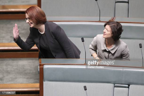 Former PM Julia Gillard waves as she sits next to Kirsten Livermore in the House of Representatives on June 27 2013 in Canberra Australia Kevin Rudd...