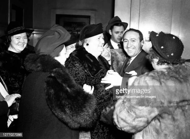 Former police Lieutenant Cuthbert J. Behan's lawyer Hyman Barshay , is greeted by Behan's wife Norda after Behan was acquitted of theft charges in...