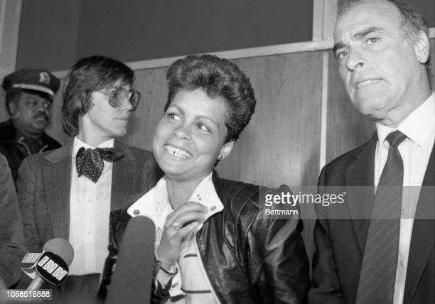 Former policewoman Cibella Borges and her attorney Joseph Giaimo answer questions during a news conference at Kennedy Airport following her return...