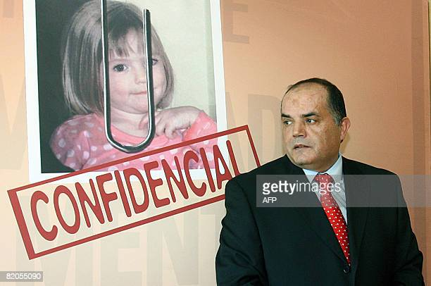 Former Policia Judiciaria detective Goncalo Amaral poses near a poster with his book entitled MaddieThe Truth about the Lie about the disappearance...