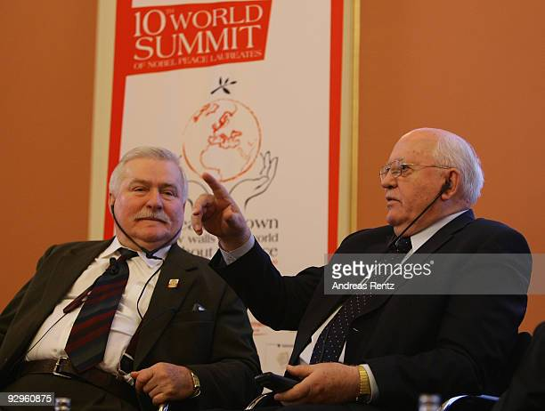 Former Polish president Lech Walesa and former Soviet President Mikhail Gorbachev gesture during their speech at the 10th World Summit of Nobel Peace...