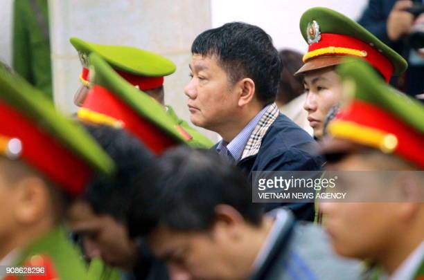 Former politburo member and former chairman of Vietnam's national oil company PetroVietnam Dinh La Thang listens along with other defendants at...