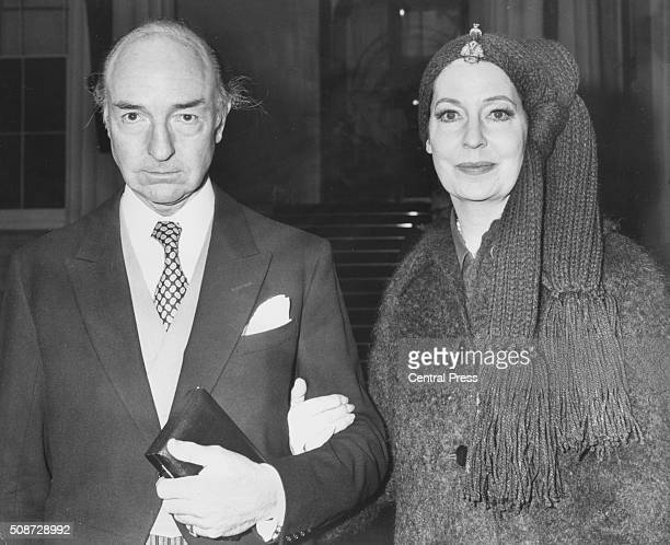 Former politician John Profumo and his wife Valerie Hobson pictured after he recieved his investiture at Buckingham Palace ten years after his...
