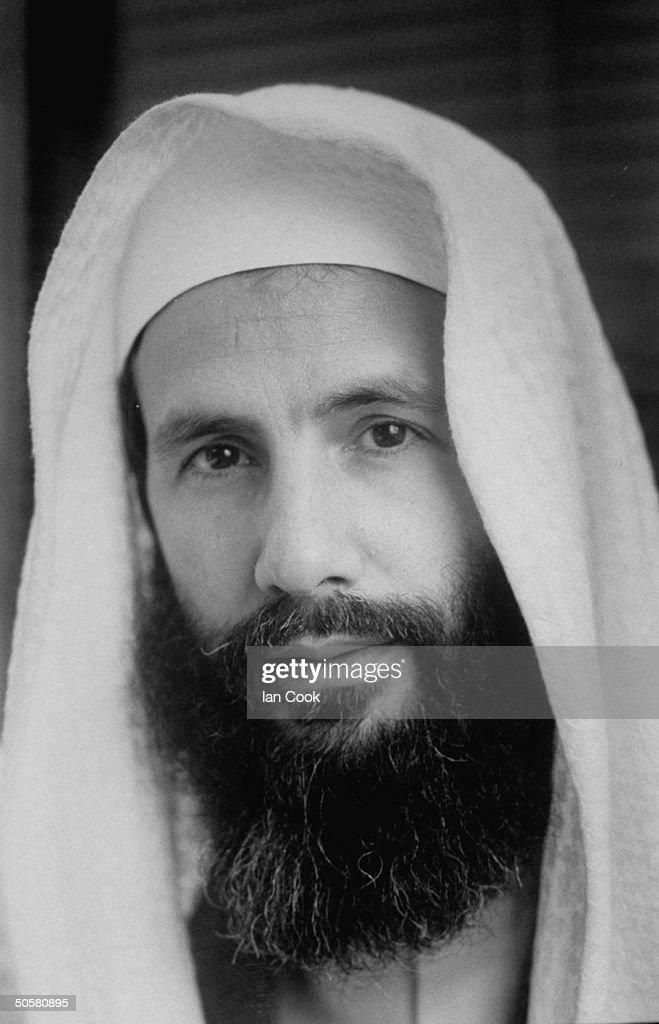 Former pop singer turned Muslim Cat Stevens, now named Yusuf Islam, wearing white head-covering posing in his office, Islamic Schools Trust, London, April 7, 1989.