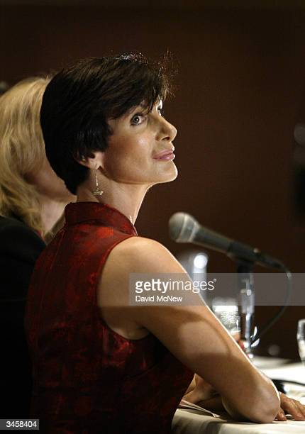 Former porn actress and cofounder of AIM HealthCare Foundation Dr Sharon Mitchell glances at producer Ira Levin as he stands at the podium during a...