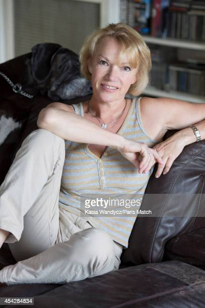 Former porn star and current tv presenter Brigitte Lahaie is photographed at home for Paris Match on July 29 2014 in Versailles France