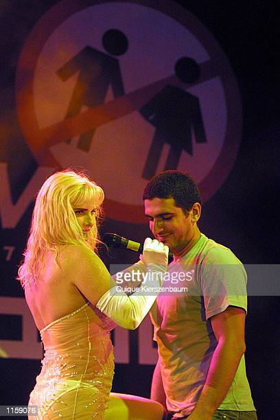 Former porn star and former member of the Italian parliament Chicholina performs with an Israeli spectator at the Love City Sexy Festival July 242002...