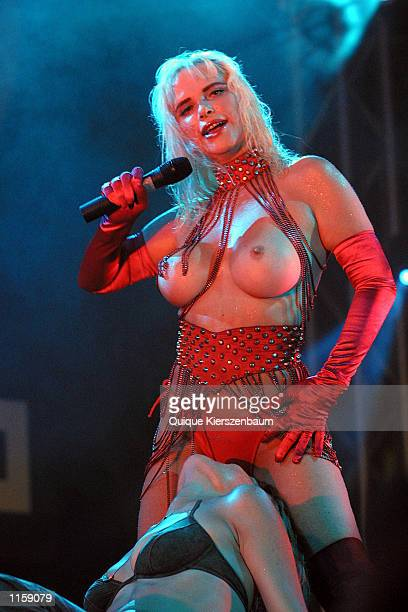 Former porn star and former member of the Italian parliament Chicholina performs with Israeli spectators at the Love City Sexy Festival July 242002...