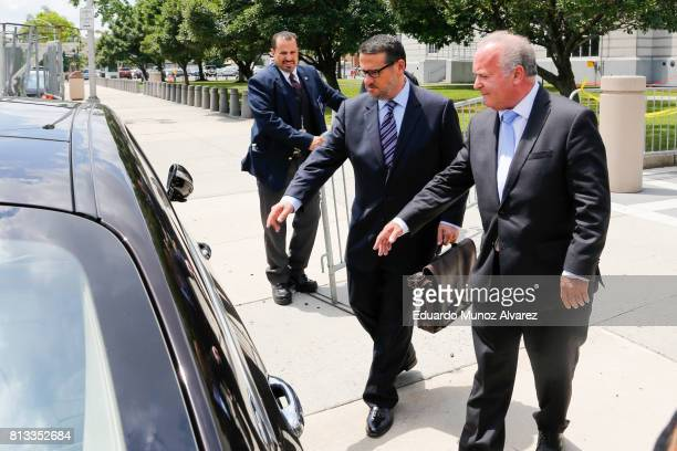 Former Port Authority official David Wildstein walks to his car with his lawyer Alan Zegas outside the federal court on July 12 2017 in Newark New...