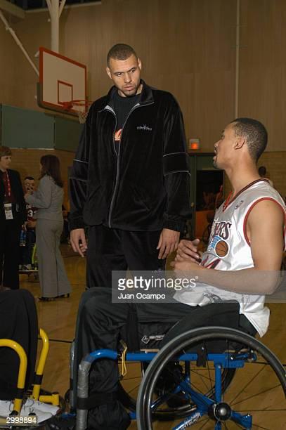Former Portland Trail Blazer Tracy Murray listens to a participant as the National Wheelchair Basketball Association hosts a Wheelchair Basketball...