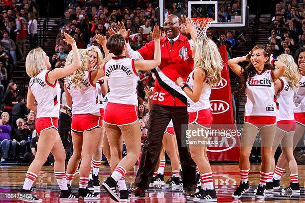 Former Portland Trail Blazers player Jerome Kersey greets the Blazer Dancers after a performance during a game between the Oklahoma City Thunder and...