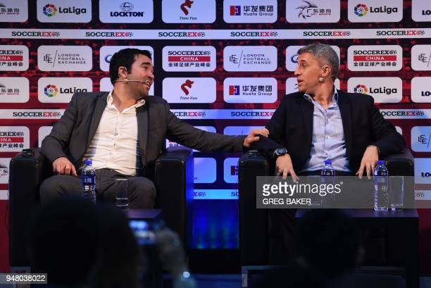 Former Portugal player Deco chats with former Argentinian player Hernan Crespo during a panel discussion about sporting heroes at the Soccerex China...