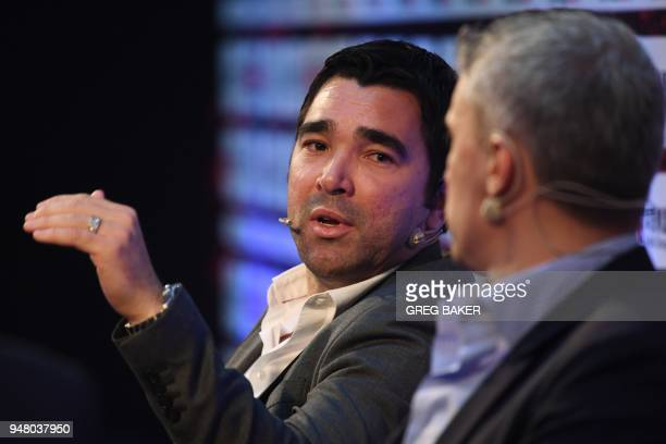 Former Portugal player Deco speaks during a panel discussion with former Argentinian player Hernan Crespo takes at the Soccerex China convention in...