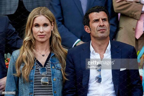 Former Portuguese football player Luis Figo and his wife the Swedish model Helen Svedin attend day nine of the Mutua Madrid Open tennis tournament at...