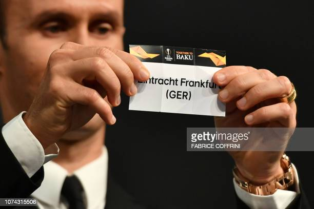 Former Portuguese football player Ricardo Carvalho shows the slip of Eintracht Frankfurt during the draw for the round of 32 of the UEFA Europa...